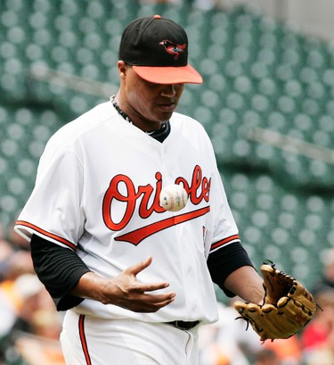Baltimore Orioles starting pitcher Alfredo Simon flips the baseball in the air after giving up a double to J.P. Arencibia of the Toronto Blue Jays that scored two runs in the fourth inning of their MLB American League baseball game in Baltimore, Maryland August 7, 2011.   (REUTERS)