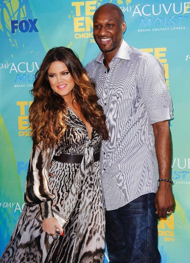 Los Angeles Lakers' Lamar Odom and wife Khloe Kardashian arrive at the Teen Choice Awards in Los Angeles August 7, 2011. REUTERS/Danny Moloshok