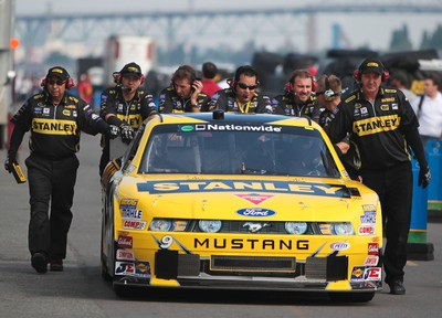 Crew push the car of Marcos Ambrose after the first  practice round during the Nascar Nationwide Series at the Circuit Gilles Villeneuve in Montreal on Aug. 19, 2011.  (ANDRE FORGET/QMI AGENCY)