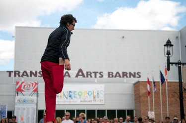 Jonathan Burns, a magician, performer and contortionist, shows off his flexibility during a performance in front of the Transalta Arts Barns at the Edmonton International Fringe Theatre Festival grounds in Edmonton, Alberta, on August 20, 2011. The festival's last day of performances, inside and outside of theatres in the Old Strathcona district of Edmonton, is Sunday. IAN KUCERAK/EDMONTON SUN/QMI AGENCY