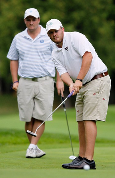 August 21, 2011  - Curtis Dancy, right, watches his putt for birdie on hole 7, as partner, Robert Mustard, looks on during the final day of the Ottawa Sun Scramble City Championships at Eagle Creek Golf Club Sunday August 21, 2011.   (DARREN BROWN/QMI AGENCY)