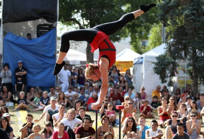 """Kimberly Craig performs acrobatics as a part of the """"street circus"""" during the final day of the Edmonton Fringe Festival in Edmonton, AB on August 21, 2011. LAURA PEDERSEN/EDMONTON SUN QMI AGENCY"""