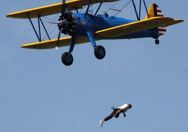 Wingwalker Todd Green falls from John Mohr's Steerman aircraft to his death, after losing his grip while trying to perform a transfer to the helicopter during Selfridge Air Show, less than 30 miles from Detroit, August 21, 2011. Picture taken August 21, 2011.  REUTERS/David Angell