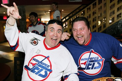 "Hockey fans Ken Savage (l) and Mike Bailey cheer at 4Play Sports Bar during a ""Bring Back the Jets"" rally in Winnipeg Saturday April 02, 2011. BRIAN DONOGH/WINNIPEG SUN/QMI AGENCY"