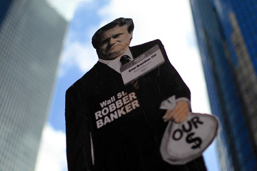 """Protesters hold a sign with a picture of Bank of America CEO Brian Moynihan during a """"Make Wall Street Banks Pay"""" protest march in Los Angeles, California October 6, 2011. Los Angeles Police said they arrested eleven people for trespassing at a Bank of America branch. (REUTERS/Lucy Nicholson)"""