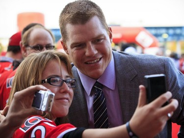 Ottawa Senator Chris Neil stops for a picture with fan Leanna Gazo as he and his teammates arrived on a red carpet for the teams 20th season home opener. Tuesday October 11,2011. (ERROL MCGIHON/THE OTTAWA SUN/QMI AGENCY).