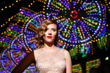 Actress Scarlett Johansson poses for photographers on the catwalk before the Dolce & Gabbana Spring/Summer 2012 women's collection during Milan Fashion Week September 25, 2011.   REUTERS/Alessandro Garofalo (ITALY - Tags: FASHION ENTERTAINMENT)