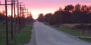 After a wet September, October has produced some beautiful weather, including this sunset on Confederation Road in Plympton-Wyoming, Ont. on Oct. 3, 2011. (HEATHER WRIGHT/QMI Agency)