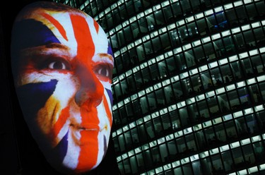 """A face in the colours of the Union Jack is seen as part of the """"Faces of Berlin"""" light installation during the Festival of Lights in Berlin October 12, 2011.  REUTERS/Thomas Peter"""