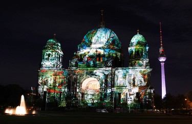 The Berliner Dom cathedral is pictured during a rehearsal for the upcoming festival of lights in Berlin October 11, 2011. Several landmarks of the German capital, including boulevards, squares, towers, historical and modern buildings, will be illuminated during the festival that runs from October 12 till 23. REUTERS/Tobias Schwarz