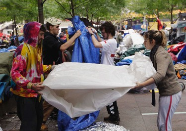 Members of the Occupy Wall Street movement clean up their campsites a day before a city sanctioned cleaning in Zuccotti Park, near the financial district of New York October 13, 2011.REUTERS/Lucas Jackson