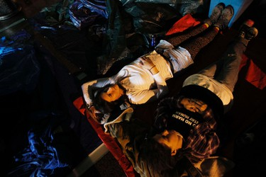 Occupy Wall Street protesters try to sleep in New York's Zuccotti Park October 14, 2011. REUTERS/Jessica Rinaldi