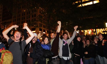 Members of the Occupy Wall St movement react after an announcement that a planned cleaning has been suspended in Zuccotti Park, near the financial district of New York October 14, 2011. REUTERS/Lucas Jackson