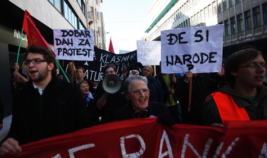"""Protesters take part in the """"Occupy Sarajevo"""" protest in Sarajevo October 15, 2011. Protesters worldwide geared up for a cry of rage on Saturday against bankers, financiers and politicians they accuse of ruining global economies and condemning millions to poverty and hardship through greed. They plan to take to the streets from Sydney to Alaska via London, Frankfurt, Washington and New York. REUTERS/Dado Ruvic"""