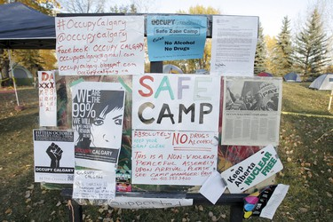 Signs welcome people to an Occupy Calgary camp on St. Patrick's Island in Calgary on Friday, October 14, 2011. The camp, which was okayed by the city, is said to be a safe zone for people who would be involved in the Occupy Calgary protest downtown the following day. LYLE ASPINALL/QMI AGENCY
