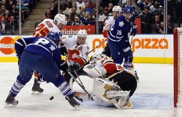 Toronto's Phil Kessel is stopped by Calgary's Miikka Kiprusoff in the first period of action at the Air Canada Centre in Toronto on Oct. 15, 2011. (DAVE ABEL/Toronto Sun/QMI Agency)