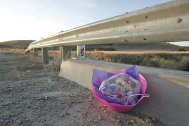 Flowers sit over Pothole Creek near Magrath, south of Lethbridge, on Sunday, October 16, 2011. Four teenagers lost their lives in a rollover crash the night before, flipping upside down into Pothole Creek. (LYLE ASPINALL/QMI AGENCY)