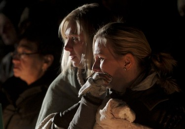 Mourners gather during a candlelight vigil in Magrath, south of Lethbridge, on Sunday, October 16, 2011. Four teenagers lost their lives in a rollover crash the night before, flipping upside down into Pothole Creek. (LYLE ASPINALL/QMI AGENCY)