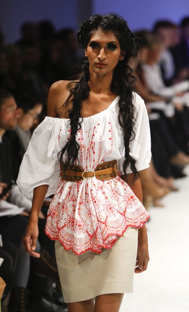 A model shows off designs by Wesley Badanjak at the Lovas spring/summer 2012 runway show at LF Fashion Week in Toronto, October 18, 2011 (Mark O'Neill/QMI Agency)