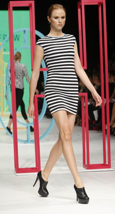 A model walks the runway at the There's No Place Like Holts Celebrating Canadian Fashion show, an event that kicks off LG Fashion Week in Toronto, October 17, 2011. (Mark O'Neill/QMI Agency)