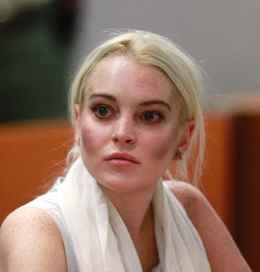 Actress Lindsay Lohan attends a progress report hearing at Airport Branch Courthouse in Los Angeles October 19, 2011.   REUTERS/Mark Boster/Pool (UNITED STATES - Tags: ENTERTAINMENT CRIME LAW)