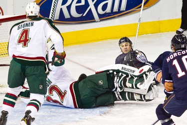 Edmonton's Ryan Smyth collides with Minnesota's Niklas Backstrom during the Edmonton Oilers NHL hockey game against the Minnesota Wild at Rexall Place in Edmonton on Friday, October 20, 2011. CODIE MCLACHLAN/EDMONTON SUN QMI AGENCY ***NOT FOR RESALE***
