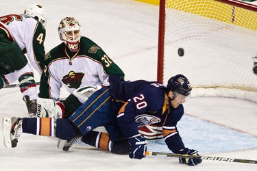 Edmonton's Eric Belanger can't get past Minnesota's Niklas Backstrom during the Edmonton Oilers NHL hockey game against the Minnesota Wild at Rexall Place in Edmonton on Friday, October 20, 2011. CODIE MCLACHLAN/EDMONTON SUN QMI AGENCY ***NOT FOR RESALE***