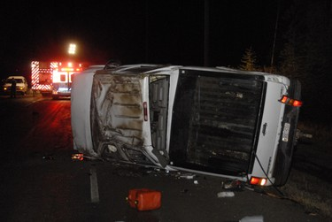 a diesel pickup truck lays on its side with the engine running following a multi-vehicle collision south of Grande Prairie on the Correction Line near Highway 40 just after midnight Saturday, October 22, 2011. At least one was pronounced dead on scene and two were ejected from the vehicle. DAN ILIKA/DAILY HERALD-TRIBUNE/QMI AGENCY