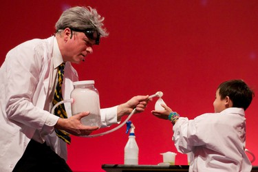 Tom Edwards, as Dr. Agar, shows six-year-old Justin Trueman a science experiment during a performance of Dr. Agar and the Halloween Science Show at Telus World of Science in Edmonton, Alberta, on Oct. 22, 2011. The all-ages show, which teaches the fun side of science, runs until Oct. 30. IAN KUCERAK/EDMONTON SUN/QMI AGENCY