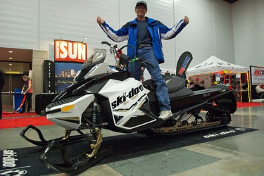 David Letendre celebrates after winning a 2012 Summit X snowmobile from BRP in an Edmonton Sun draw at the 2012 Alberta Snowmobile ATV and Off-Road Show at the Edmonton Expo Centre in Edmonton, Alberta, on Oct. 23, 2011. The craft is worth $15,000. IAN KUCERAK/EDMONTON SUN/QMI AGENCY