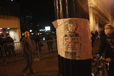 """A sign is seen at an """"Occupy Wall Street"""" demonstration in Oakland, California October 25, 2011. (REUTERS/Stephen Lam)"""