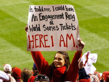 A baseball fan holds up a sign during Game 6 of MLB's World Series baseball championship in St. Louis, Missouri, October 27, 2011 featuring the Texas Rangers vs. the St. Louis Cardinals. (REUTERS/Jim Young)
