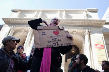 A protester affiliated with the Occupy Wall Street movement makes an announcement to a crowd while preparing to march to the Bank of America Building at 42nd Street and Sixth Avenue in New York on Oct. 28, 2011. (REUTERS/Andrew Burton)