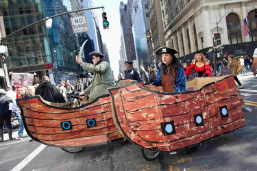 Protesters affiliated with the Occupy Wall Street movement riding bicycles made to look like pirate ships, march to the Bank of America Building at 42nd Street and Sixth Avenue in New York on Oct. 28, 2011. (REUTERS/Andrew Burton)