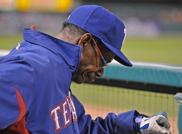 Texas Rangers manager Ron Washington reacts in the dugout during the eighth inning of play against the St. Louis Cardinals in Game 7 of MLB's World Series baseball championship in St. Louis, Missouri, October 28, 2011.  REUTERS/Ray Stubblebine