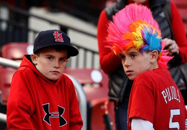 St. Louis Cardinals fans are dressed to support their team before they met the Texas Rangers in Game 7 of MLB's World Series baseball championship in St. Louis, Missouri, October 28, 2011.  REUTERS/Jeff Haynes
