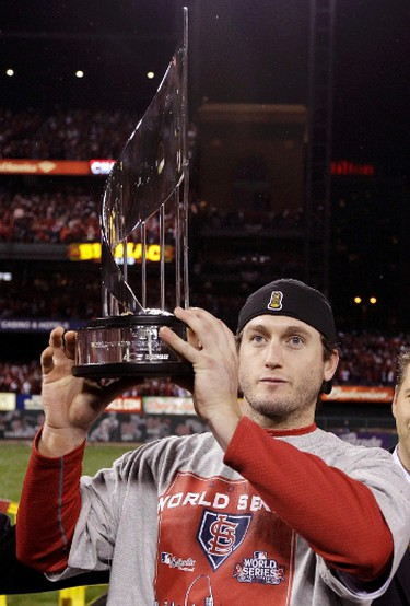 St. Louis Cardinals third baseman David Freese holds up the trophy after being named Most Valuable Player of the World Series after the Cardinals defeated the Texas Rangers in Game 7 to win MLB's World Series baseball championship in St. Louis, Missouri, October 28, 2011. REUTERS/Charlie Riedel/POOL