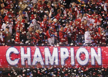 Fans celebrate in Busch Stadium after the St. Louis Cardinals defeated the Texas Rangers in Game 7 to win MLB's World Series baseball championship in St. Louis, Missouri, October 28, 2011. REUTERS/Sarah Conard