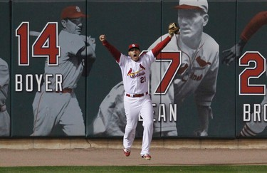 St. Louis Cardinals left fielder Allen Craig celebrates making the final out to defeat the Texas Rangers and win the championship in Game 7 of MLB's World Series in St. Louis, Missouri, October 28, 2011. REUTERS/Sarah Conard