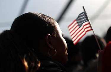 New U.S. citizens celebrate after taking the oath of citizenship during a naturalization ceremony beneath the Statue of Liberty during ceremonies marking the 125th anniversary of the Statue at Liberty Island in New York, October 28,  2011.  REUTERS/Mike Segar