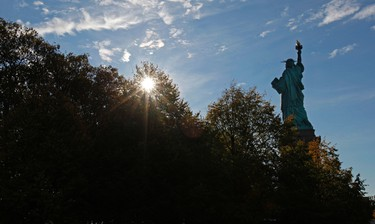 The Statue of Liberty is seen early on October 28, 2011 during ceremonies marking the 125th anniversary of the Statue at Liberty Island in New York. REUTERS/Mike Segar