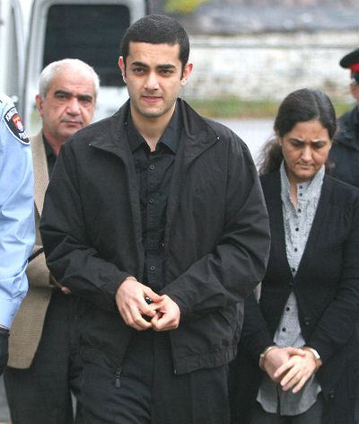Mohammad Shafia, left, his son Hamed and his wife Tooba Mohammad Yahya are brought into the court house in Kingston, Ont. on October 21, 2011. (MICHAEL LEA/Postmedia Network)