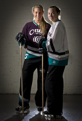 Jayme Simzer (left) and Carrie Lugg play for the Ottawa Ice of the National Ringette League.