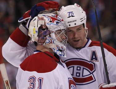Montreal Canadiens Hal Gill congratulates goaltender Carey Price on his 2-1 victory over the Ottawa Senators  in NHL hockey action at Scotiabank Place. November 4,2011. (ERROL MCGIHON/THE OTTAWA SUN/QMI AGENCY)
