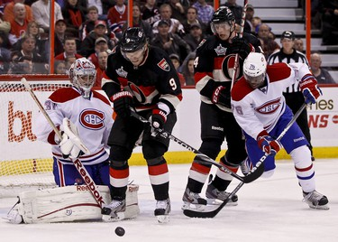 Ottawa Senators Milan Michalek (#9) and Colin Greening battle with Montreal Canadiens P.K. Subaban for a loose puck in front of Montreal netminder carey Price in NHL hockey action at Scotiabank Place. November 4,2011. (ERROL MCGIHON/THE OTTAWA SUN/QMI AGENCY)