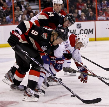 Ottawa Senators Milan Michalek (#9) and Colin Greening (#14) battle for a loose puck with Montreal Canadiens Hal Gill and Josh Gorges in NHL hockey action at Scotiabank Place. November 4,2011. (ERROL MCGIHON/THE OTTAWA SUN/QMI AGENCY)