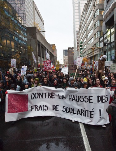 Student groups and unions march in Montreal near PM Jean Charest's offices Thursday November 10th 2011 to protest the latest tuition fee raise. (PHILIPPE-OLIVIER CONTANT/QMI AGENCY)