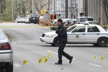 Police investigate an early morning shooting that killed one man in the Exchange District downtown Winnipeg. Olice were called around 2:30 a.m. to Rorie Street and McDermot Avenue for shots fired and found an injured male a few blocks away on Arthur Street. The man succummed to his injuries later in hospital. (Stephen Ripley/Winnipeg Sun)