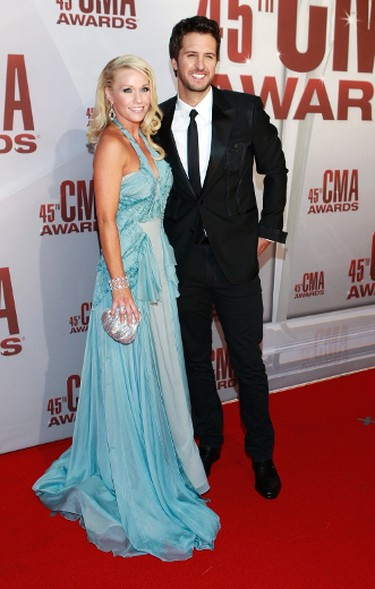 Singer Luke Bryan and his wife Caroline arrive at the 45th Country Music Association Awards in Nashville, Tennessee, November 9, 2011. REUTERS/Harrison McClary (UNITED STATES - Tags: ENTERTAINMENT)