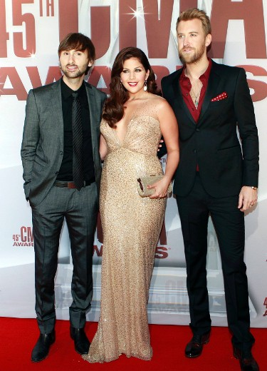 Dave Haywood, Hillary Scott and Charles Kelley (L-R) of country trio Lady Antebellum arrive at the 45th Country Music Association Awards in Nashville, Tennessee, November 9, 2011. REUTERS/Harrison McClary (UNITED STATES  - Tags: ENTERTAINMENT)